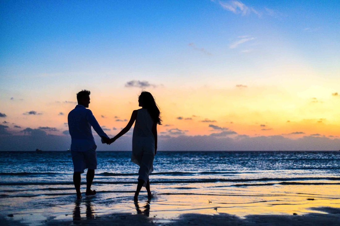 https://www.pexels.com/photo/man-and-woman-holding-hands-walking-on-seashore-during-sunrise-1024960/