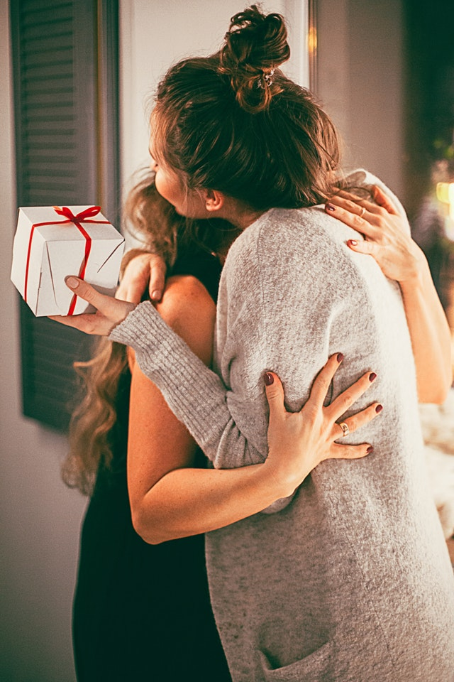 https://www.pexels.com/photo/two-woman-hugging-each-other-1261368/